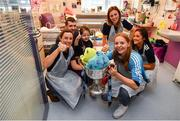 16 September 2019; Dublin ladies footballers, from left, Lyndsey Davey, Ciara Trant, Muireann Ní Scanaill and Sarah Fagan with Holly Carroll, age 4, and her father Jamie, from Co Tipperary during the TG4 All-Ireland Senior Ladies Football Champions visit to Our Lady's Children's Hospital in Crumlin, Co Dublin. Photo by David Fitzgerald/Sportsfile