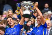 15 September 2019; Tipperary's Anna Rose Kennedy, left, and Caitlín Kennedy lift the Mary Quinn Memorial Cup following the TG4 All-Ireland Ladies Football Intermediate Championship Final match between Meath and Tipperary at Croke Park in Dublin. Photo by Stephen McCarthy/Sportsfile