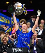 15 September 2019; Tipperary's Aishling Moloney lifts the Mary Quinn Memorial Cup following the TG4 All-Ireland Ladies Football Intermediate Championship Final match between Meath and Tipperary at Croke Park in Dublin. Photo by Stephen McCarthy/Sportsfile