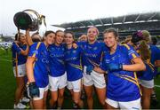 15 September 2019; Tipperary players, from left, Anna Rose Kennedy, Samantha Lambert, Maria Curley, Orla O'Dwyer and Laura Dillon celebrate with the Mary Quinn Memorial Cup following the TG4 All-Ireland Ladies Football Intermediate Championship Final match between Meath and Tipperary at Croke Park in Dublin. Photo by Stephen McCarthy/Sportsfile