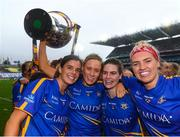 15 September 2019; Tipperary players, from left, Anna Rose Kennedy, Samantha Lambert, Maria Curley and Orla O'Dwyer celebrate with the Mary Quinn Memorial Cup following the TG4 All-Ireland Ladies Football Intermediate Championship Final match between Meath and Tipperary at Croke Park in Dublin. Photo by Stephen McCarthy/Sportsfile