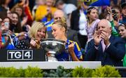 15 September 2019; Tipperary captain Samantha Lambert is presented with the the Mary Quinn Memorial Cup by LGFA President Marie Hickey following the TG4 All-Ireland Ladies Football Intermediate Championship Final match between Meath and Tipperary at Croke Park in Dublin. Photo by Stephen McCarthy/Sportsfile