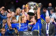 15 September 2019; Tipperary's Katie Cunningham, left, and Bríd Condon lift the Mary Quinn Memorial Cup following the TG4 All-Ireland Ladies Football Intermediate Championship Final match between Meath and Tipperary at Croke Park in Dublin. Photo by Stephen McCarthy/Sportsfile
