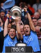 15 September 2019; Aoife Kane, left, and Lauren Magee of Dublin lift the Brendan Martin Cup following the TG4 All-Ireland Ladies Football Senior Championship Final match between Dublin and Galway at Croke Park in Dublin. Photo by Stephen McCarthy/Sportsfile