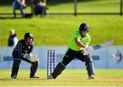 17 September 2019; Gary Wilson of Ireland plays a shot, watched on by Matthew Cross of Scotland, during the T20 International Tri Series match between Ireland and Scotland at Malahide Cricket Club in Dublin. Photo by Seb Daly/Sportsfile