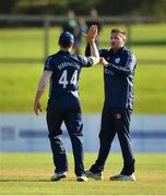 17 September 2019; Mark Watt of Scotland, right, is congratulated by team-mate Richie Berrington after trapping Lorcan Tucker of Ireland lbw during the T20 International Tri Series match between Ireland and Scotland at Malahide Cricket Club in Dublin. Photo by Seb Daly/Sportsfile