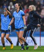 15 September 2019; Dublin players, from left, Hannah O'Neill, Rachel Ruddy, and Nicole Owens celebrate after the TG4 All-Ireland Ladies Football Senior Championship Final match between Dublin and Galway at Croke Park in Dublin. Photo by Piaras Ó Mídheach/Sportsfile