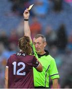 15 September 2019; Referee Brendan Rice shows the yellow card to Mairéad Seoighe of Galway, for a late challenge on Dublin goalkeeper Ciara Trant, during the TG4 All-Ireland Ladies Football Senior Championship Final match between Dublin and Galway at Croke Park in Dublin. Photo by Piaras Ó Mídheach/Sportsfile