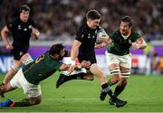 21 September 2019; Beauden Barrett of New Zealand is tackled by Franco Mostert, right and Frans Malherbe of South Africa during the 2019 Rugby World Cup Pool B match between New Zealand and South Africa at the International Stadium in Yokohama, Japan. Photo by Ramsey Cardy/Sportsfile