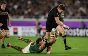 21 September 2019; Beauden Barrett of New Zealand is tackled by Frans Malherbe of South Africa during the 2019 Rugby World Cup Pool B match between New Zealand and South Africa at the International Stadium in Yokohama, Japan. Photo by Ramsey Cardy/Sportsfile