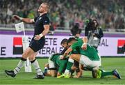 22 September 2019; Andrew Conway is congratulated by his Ireland team-mates Conor Murray, right, and Jonathan Sexton after scoring their side's fourth try during the 2019 Rugby World Cup Pool A match between Ireland and Scotland at the International Stadium in Yokohama, Japan. Photo by Brendan Moran/Sportsfile