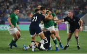 22 September 2019; Jacob Stockdale of Ireland is tackled by Scotland players, from left, Ali Price, Darcy Graham and Stuart Hogg during the 2019 Rugby World Cup Pool A match between Ireland and Scotland at the International Stadium in Yokohama, Japan. Photo by Ramsey Cardy/Sportsfile