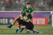 22 September 2019; Chris Farrell of Ireland is tackled by Finn Russell of Scotland during the 2019 Rugby World Cup Pool A match between Ireland and Scotland at the International Stadium in Yokohama, Japan. Photo by Brendan Moran/Sportsfile