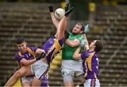 22 September 2019; Sean Quigley of Roslea Shamrocks in action against Shane McGullion, Stephen McGullion and Tiarnan Daly of Derrygonnelly Harps during the Fermanagh County Senior Club Football Championship Final match between Derrygonnelly Harps and Roslea Shamrocks at Brewster Park in Enniskillen, Fermanagh. Photo by Oliver McVeigh/Sportsfile