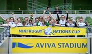 22 September 2019; Aviva Ireland gave 400 children the dream opportunity to take part in the Aviva Mini Nations Cup in Aviva Stadium on Sunday, September 22. 20 U10 boys' and U12 girls' teams from clubs nationwide took to the hallowed pitch after Ireland's heroic win over Scotland in Japan for their very own Mini Rugby Nations Cup. See aviva.ie/safetodream or @AvivaIreland social channels for details. Players from Greystones RFC, Wicklow, representing England lifting the cup following the Aviva Mini Rugby Nations Cup at Aviva Stadium in Dublin. Photo by Eóin Noonan/Sportsfile