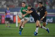 22 September 2019; Chris Farrell of Ireland releases a pass in the build up to Ireland's fourth try despite the tackle of Finn Russell of Scotland during the 2019 Rugby World Cup Pool A match between Ireland and Scotland at the International Stadium in Yokohama, Japan. Photo by Brendan Moran/Sportsfile