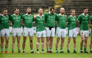 22 September 2019; The Roslea Shamrocks standing for the anthem before the Fermanagh County Senior Club Football Championship Final match between Derrygonnelly Harps and Roslea Shamrocks at Brewster Park in Enniskillen, Fermanagh. Photo by Oliver McVeigh/Sportsfile