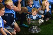 14 September 2019; Donagh Brogan, son of Dublin footballer Bernard Brogan, in the Sam Maguire Cup after the GAA Football All-Ireland Senior Championship Final Replay between Dublin and Kerry at Croke Park in Dublin. Photo by Piaras Ó Mídheach/Sportsfile
