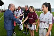 6 July 2019; Liam McDonagh, President of the Connacht Council, LGFA, meets Galway captain Tracey Leonard prior to the 2019 TG4 Connacht Ladies Senior Football Final replay between Galway and Mayo at the LIT Gaelic Grounds in Limerick. Photo by Brendan Moran/Sportsfile