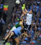14 September 2019; Dublin goalkeeper and captain Stephen Cluxton punches the ball clear, supporterd byJonny Cooper, under pressure from Kerry's Stephen O'Brien during the GAA Football All-Ireland Senior Championship Final Replay match between Dublin and Kerry at Croke Park in Dublin. Photo by Ray McManus/Sportsfile