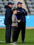 27 September 2019; Kilmacud Crokes joint managers Johnny Magee, left, Robbie Brennan and his son, Tadhg, watch the warm-up prior to the Dublin County Senior Club Football Championship Group 1 match between Kilmacud Crokes and St Sylvester's at Parnell Park in Dublin. Photo by Harry Murphy/Sportsfile