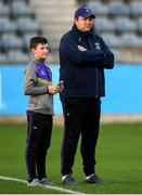 27 September 2019; Kilmacud Crokes joint manager Robbie Brennan and his son, Tadhg, watch the warm-up prior to the Dublin County Senior Club Football Championship Group 1 match between Kilmacud Crokes and St Sylvester's at Parnell Park in Dublin. Photo by Harry Murphy/Sportsfile