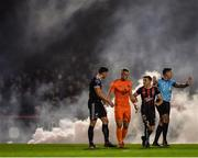 27 September 2019; Bohemians players, from left, Rob Cornwall, James Talbot and Keith Buckley in conversation after their side conceded a goal during the Extra.ie FAI Cup Semi-Final match between Bohemians and Shamrock Rovers at Dalymount Park in Dublin. Photo by Seb Daly/Sportsfile