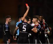 27 September 2019; Daniel Mandroiu of Bohemians, centre, is shown a red card by referee Robert Hennessy during the Extra.ie FAI Cup Semi-Final match between Bohemians and Shamrock Rovers at Dalymount Park in Dublin. Photo by Seb Daly/Sportsfile
