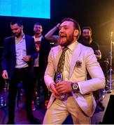27 September 2019; UFC fighter Conor McGregor celebrates after team-mate Peter Queally was declared victorious over Ryan Scope in their welterweight bout at Bellator Dublin in the 3Arena, Dublin. Photo by David Fitzgerald/Sportsfile