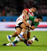 28 September 2019; Joey Carbery of Ireland is tackled by Ryoto Nakamura, left, and Shota Horie of Japan during the 2019 Rugby World Cup Pool A match between Japan and Ireland at the Shizuoka Stadium Ecopa in Fukuroi, Shizuoka Prefecture, Japan. Photo by Brendan Moran/Sportsfile