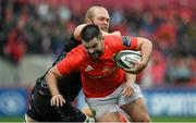 28 September 2019; Kevin O'Byrne of Munster is tackled by Joes Davies of Dragons during the Guinness PRO14 Round 1 match between Munster and Dragons at Thomond Park in Limerick. Photo by Matt Browne/Sportsfile