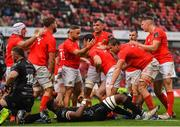 28 September 2019; Mike Haley of Munster is congratulated by Alby Mathewson and team-mates after scoring his side's fifth try during the Guinness PRO14 Round 1 match between Munster and Dragons at Thomond Park in Limerick. Photo by Harry Murphy/Sportsfile