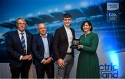 28 September 2019; Pictured is the Electric Ireland Minor Hurling All Star winner Cian Galvin of Clare at the 2019 Electric Ireland Minor Star Awards alongside, from left, Munster Council chairman Liam Lenihan, Derek McGrath and Executive Director of ESB Marguerite Sayers. The Hurling Team of the Year was selected by an expert panel of GAA legends including Alan Kerins, Derek McGrath, Karl Lacey and Tomás Quinn. The Electric Ireland GAA Minor Star Awards create a major moment for Minor players, showcasing the outstanding achievements of individual performers throughout the Championship season. The awards also recognise the effort of those who support them day in and day out, from their coaches to parents, clubs and communities. #GAAThisIsMajor Photo by David Fitzgerald/Sportsfile