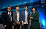 28 September 2019; Pictured is the Electric Ireland Minor Football All Star winner Ethan Henry of Mayo at the 2019 Electric Ireland Minor Star Awards alongside, from left, Munster Council chairman Liam Lenihan, Tomás Quinn and Executive Director of ESB Marguerite Sayers. The Football Team of the Year was selected by an expert panel of GAA legends including Alan Kerins, Derek McGrath, Karl Lacey and Tomás Quinn. The Electric Ireland GAA Minor Star Awards create a major moment for Minor players, showcasing the outstanding achievements of individual performers throughout the Championship season. The awards also recognise the effort of those who support them day in and day out, from their coaches to parents, clubs and communities. #GAAThisIsMajor Photo by David Fitzgerald/Sportsfile