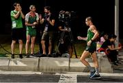 28 September 2019; Irish 400m hurdler Thomas Barr, centre, and Ireland supporter Darragh Bambrick, left, encourage Brendan Boyce of Ireland as he competes in the Men's 50km Race Walk during day two of the World Athletics Championships 2019 at The Corniche in Doha, Qatar. Photo by Sam Barnes/Sportsfile