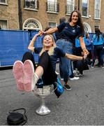 29 September 2019; Dublin footballer Nicole Owens sits in the Brendan Martin cup while her team-mate Niamh Hetherton stands behind her during the Dublin Senior Football teams homecoming at Merrion Square in Dublin. Photo by David Fitzgerald/Sportsfile