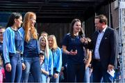 29 September 2019; MC Marty Morrissey with Dublin players, from right, Sinéad Aherne, Ciara Trant and Sinéad Goldrick during the Dublin Senior Football teams homecoming at Merrion Square in Dublin. Photo by Piaras Ó Mídheach/Sportsfile