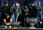29 September 2019; Dublin footballer Michael Darragh Macauley takes a photograph of the Delaney and Sam Maguire Cups during the Dublin Senior Football teams homecoming at Merrion Square in Dublin. Photo by Piaras Ó Mídheach/Sportsfile