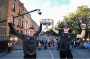 29 September 2019; Brian Howard, left, and Brian Fenton celebrate with the Sam Maguire cup during the Dublin Senior Football teams homecoming with the Sam Maguire Cup at Merrion Square in Dublin. Photo by David Fitzgerald/Sportsfile