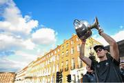 29 September 2019; Brian Fenton celebrates with the Sam Maguire cup during the Dublin Senior Football teams homecoming with the Sam Maguire Cup at Merrion Square in Dublin. Photo by David Fitzgerald/Sportsfile