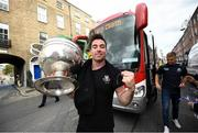 29 September 2019; Michael Darragh Macauley gets off the bus with the Sam Maguire Cup during the Dublin Senior Football teams homecoming at Merrion Square in Dublin. Expressway as official carriers of the Dublin senior football team are proud to have carried the Dubs to a historic 5 in a row. Expressway has been official carriers of Dublin GAA since 2015 and each year since Dublin have won the Sam Maguire trophy. Photo by David Fitzgerald/Sportsfile