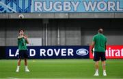 3 October 2019; Joey Carbery of Ireland, left, passes to team-mate Rory Best before the 2019 Rugby World Cup Pool A match between Ireland and Russia at the Kobe Misaki Stadium in Kobe, Japan. Photo by Brendan Moran/Sportsfile