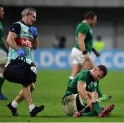 3 October 2019; Ireland team doctor Dr Ciaran Cosgrove comes to the aid of Tadhg Beirne of Ireland during the 2019 Rugby World Cup Pool A match between Ireland and Russia at the Kobe Misaki Stadium in Kobe, Japan. Photo by Brendan Moran/Sportsfile