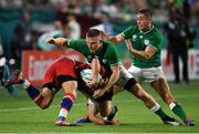 3 October 2019; Andrew Conway of Ireland, with the assistance of team-mate Jordan Larmour, tackles Dmitry Perov of Russia during the 2019 Rugby World Cup Pool A match between Ireland and Russia at the Kobe Misaki Stadium in Kobe, Japan. Photo by Brendan Moran/Sportsfile