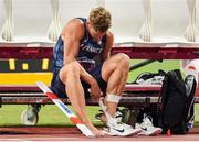 3 October 2019; Kevin Mayer of France removes tape from his left foot after pulling up in the Pole Vault of the Men's Decathlon during day seven of the 17th IAAF World Athletics Championships Doha 2019 at the Khalifa International Stadium in Doha, Qatar. Photo by Sam Barnes/Sportsfile