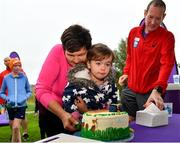 5 October 2019; Amy Cranley, age 2, helps volunteer Liz O'Dwyer cut the event birthday cake at the Father Collins parkrun at Father Collins park, The Hole in The Wall Rd, Dublin, where Vhi hosted a special event to celebrate their partnership with parkrun Ireland. Olympian Mick Clohisey was on hand to lead the warm up for parkrun participants before completing the 5km free event. Parkrunners enjoyed refreshments post event at the Vhi Rehydrate, Relax, Refuel and Reward areas. Parkrun in partnership with Vhi support local communities in organising free, weekly, timed 5k runs every Saturday at 9.30am. To register for a parkrun near you visit www.parkrun.ie. Photo by Seb Daly/Sportsfile