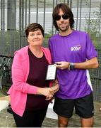 5 October 2019; Volunteer Liz O'Dwyer is presented with an award by Olympian Mick Clohisey ahead of the Father Collins parkrun at Father Collins park, The Hole in The Wall Rd, Dublin, where Vhi hosted a special event to celebrate their partnership with parkrun Ireland. Mick was on hand to lead the warm up for parkrun participants before completing the 5km free event. Parkrunners enjoyed refreshments post event at the Vhi Rehydrate, Relax, Refuel and Reward areas. Parkrun in partnership with Vhi support local communities in organising free, weekly, timed 5k runs every Saturday at 9.30am. To register for a parkrun near you visit www.parkrun.ie. Photo by Seb Daly/Sportsfile