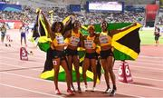 5 October 2019; The Jamican women's 4x100m relay team, from left, Natalliah Whyte, Shericka Jackson, Shelly-ann Fraser-Pryce and Jonielle Smith celebrate after winning a gold medal during day nine of the 17th IAAF World Athletics Championships Doha 2019 at the Khalifa International Stadium in Doha, Qatar. Photo by Sam Barnes/Sportsfile