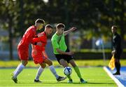 6 October 2019; Eoin Whelan of Connacht FA in action against Ian Mylod, left, and Anthony O'Donnell of Munster Senior League during the FAI Michael Ward Inter League Tournament match between Munster Senior League and Connacht FA at Kilbarrack United in Dublin. Photo by Seb Daly/Sportsfile