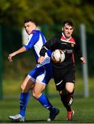6 October 2019; Oisin Langan of Ulster Senior League in action against Darren Craven of Leinster Senior League during the FAI Michael Ward Inter League Tournament match between Leinster Senior League and Ulster Senior League at Hartstown Huntstown Football Club in Dublin. Photo by Harry Murphy/Sportsfile